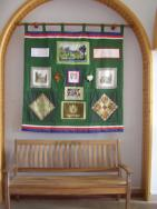 Darley Dale\'s gifts to Onzain for the 20th anniversary - a comemorative bench and a patchwork quilt with Derbyshire scenes made by ladies of Darley Dale.
